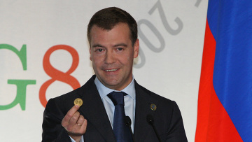 Dimitri Medcedev at G8 sum showing a gold coin