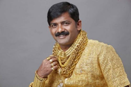 Indian man full of gold